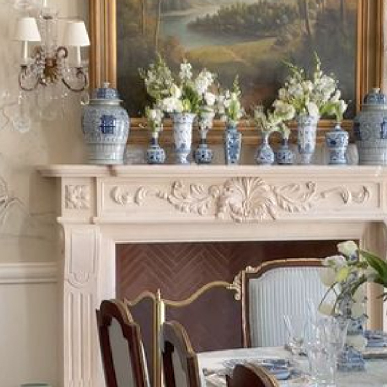 Traditional beautiful blue and white porcelain on a French fireplace mantel in Tina's dining room - The Enchanted Home.