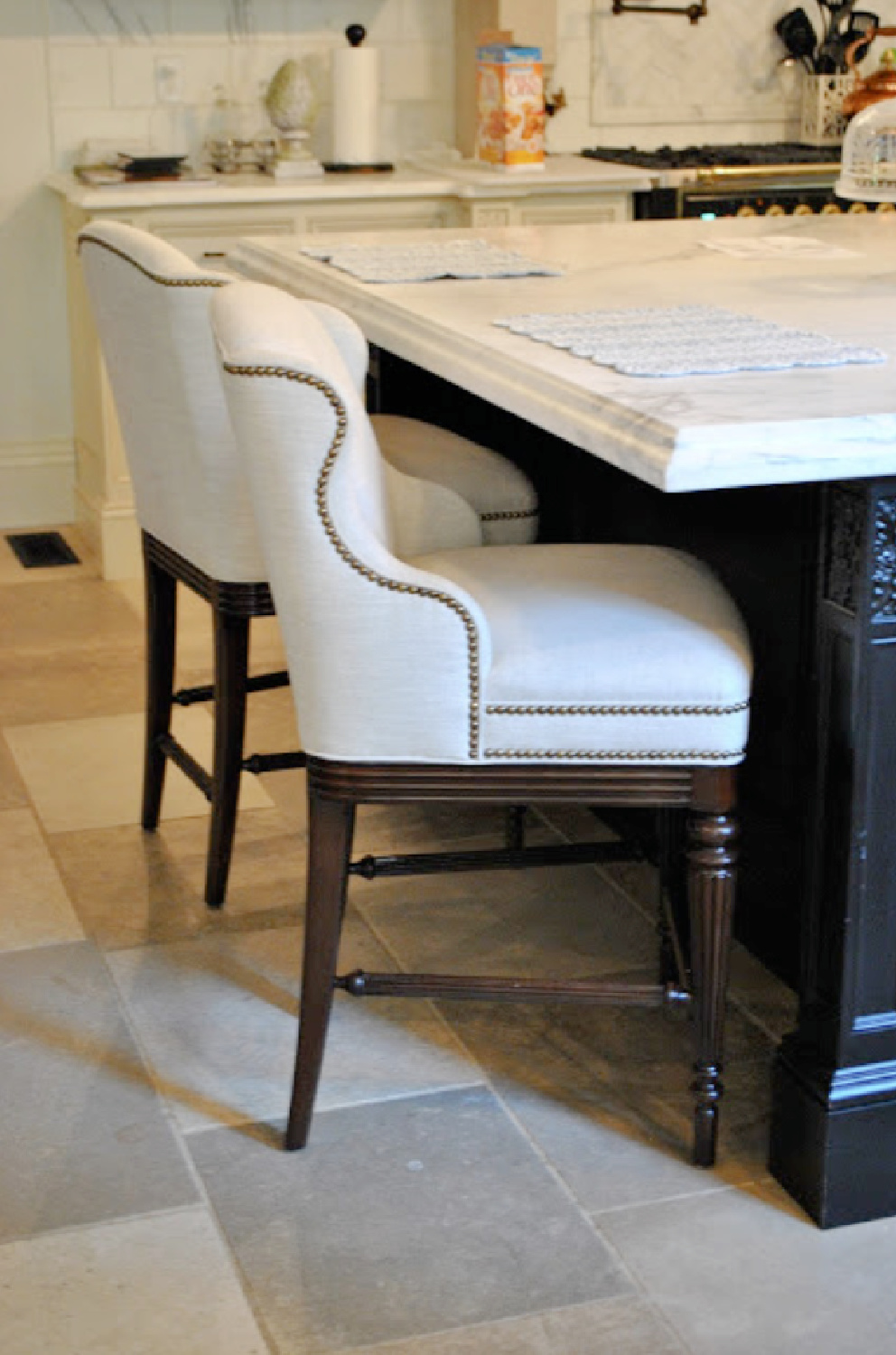 Detail of nailhead trim on counterstools in Tina's beautiful French country kitchen - The Enchanted Home.