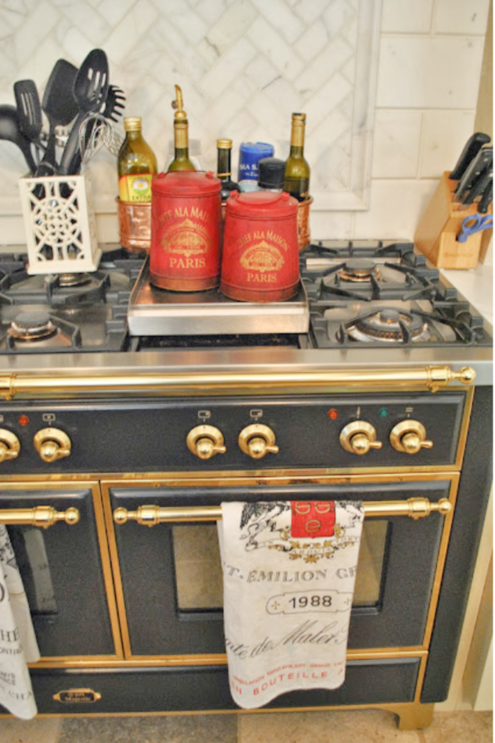 Beautiful black and gold French Lacanche range in Tina's beautiful kitchen - The Enchanted Home.