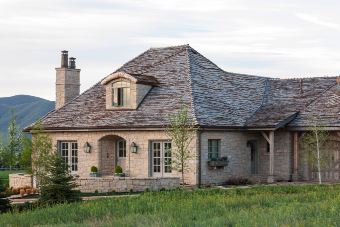 Exquisite French country with Gustavian influence cottage exterior in Utah - Decor de Provence. #frenchcottage #frenchnordic #frenchcountry #houseexteriors