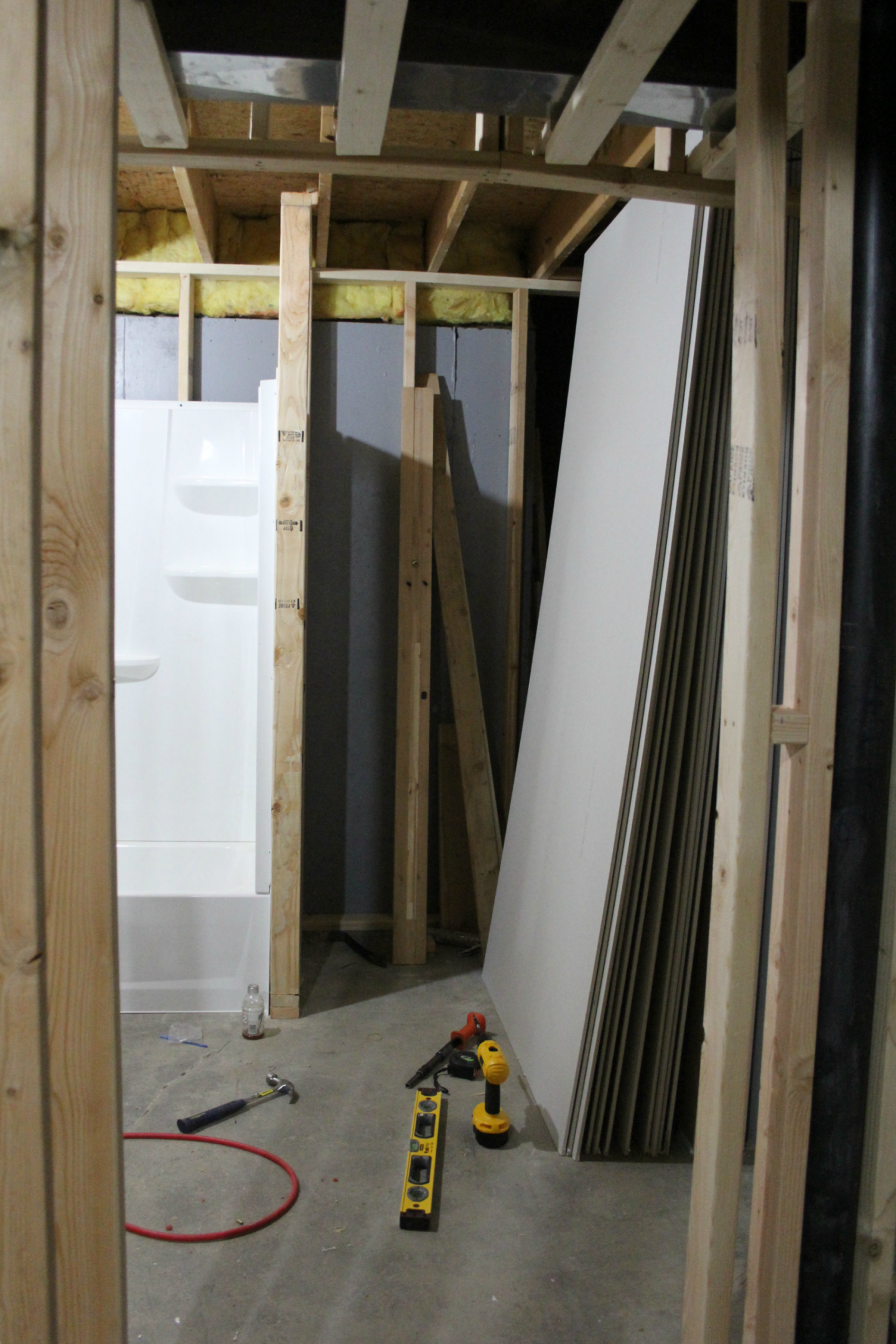 See how we added a full bathroom to our home, stealing unfinished space in the basement. #beforeandafter #renovation #bathroomdesign
