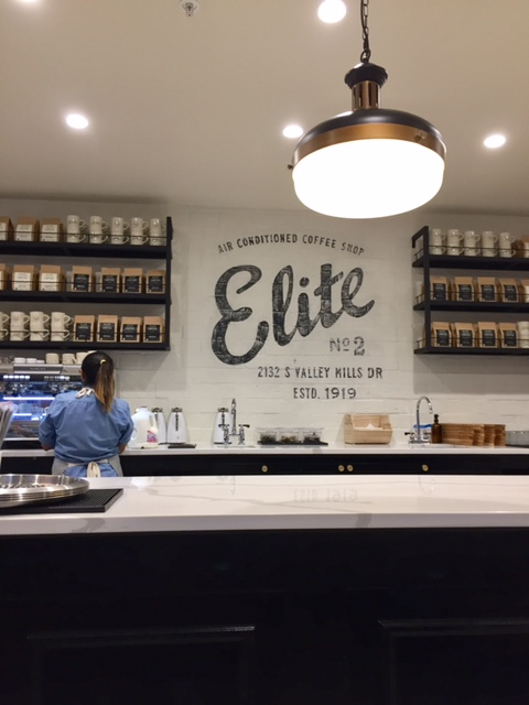 Magnolia Table restaurant coffee bar with Elite Cafe sign and long marble bar with vintage style lighting. #fixerupper #magnoliatable #restaurant #bar #EliteCafe