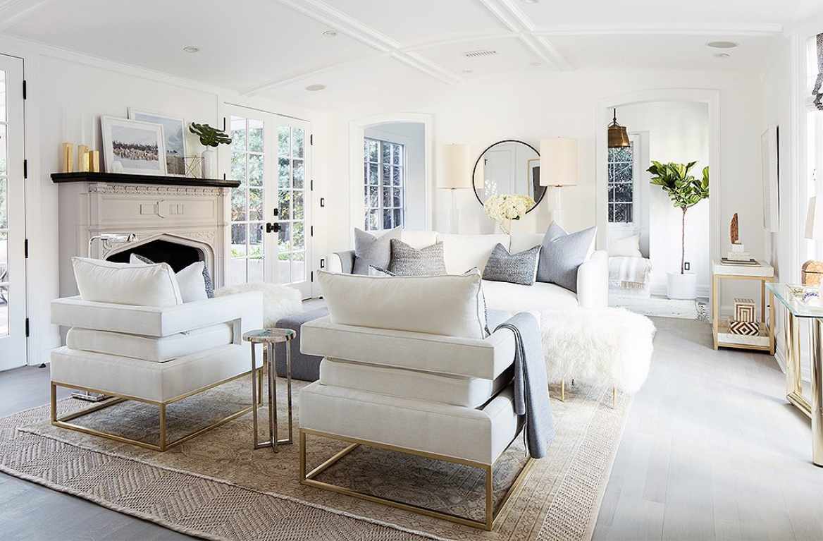 "Modern farmhouse living room with Mid-century modern style. The club chairs, Alex says, ""have a great architectural line and a sexy cut from the back,"" making them ideal for a central seating arrangement. #livingroom #allwhite #serenedecor #interiordesign #modernfarmhouse"