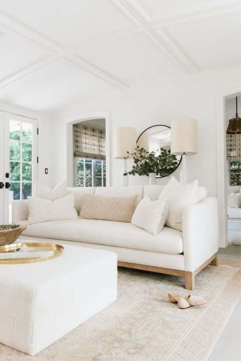 Erin Fetherston white living room with organic, modern farmhouse decor style. #livingroomdecor #interiordesign #allwhite #interiordesign #whitesofa