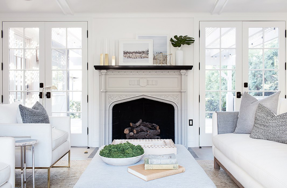 Modern rustic luxe farmhouse living room with midcentury modern style. Vintage fireplace and white linen upholstery mix with Chantilly Lace painted walls. #livingroom #whitelivingroom #chantillylace #modernrustic #whiteonwhite