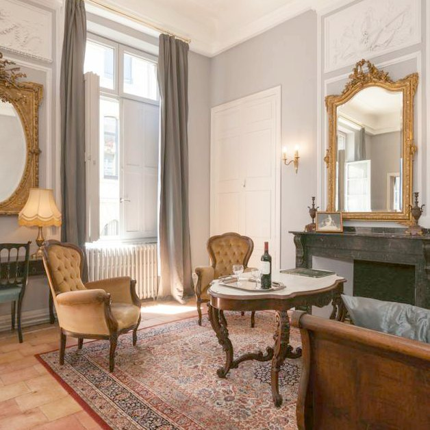 Luxurious and palatial French apartment from the 1600's to rent in Carcassonne! Gilt mirrors, classic French decor, modern convenience, and history! #vacationrental #southoffrance #French #apartment