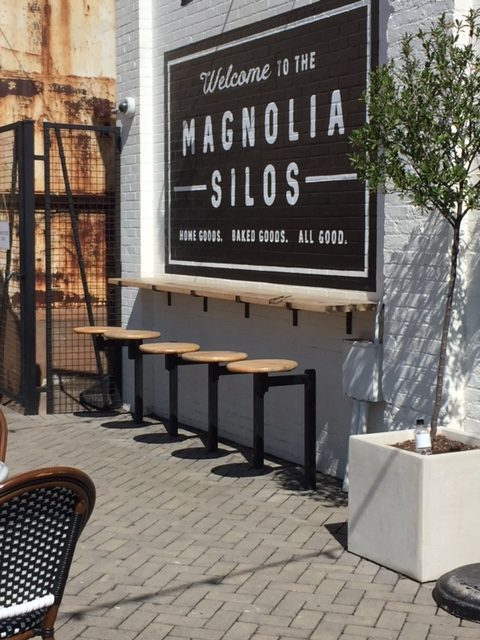 Magnolia Silos in Waco - Silos Baking Co. has a lovely outdoor patio with counter, bar stools, Parisian bistro chairs, and marble topped tables. #magnolia #silos #bakery