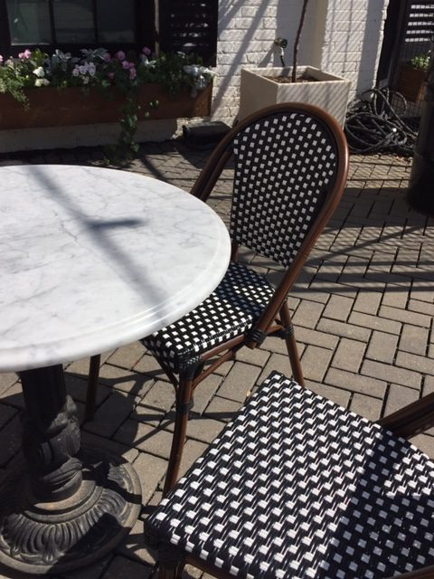 Black and white bistro chairs and marble cafe table at Silos Baking Co. at Magnolia Market in Waco, Texas. #magnolia #silos #bakery #patio