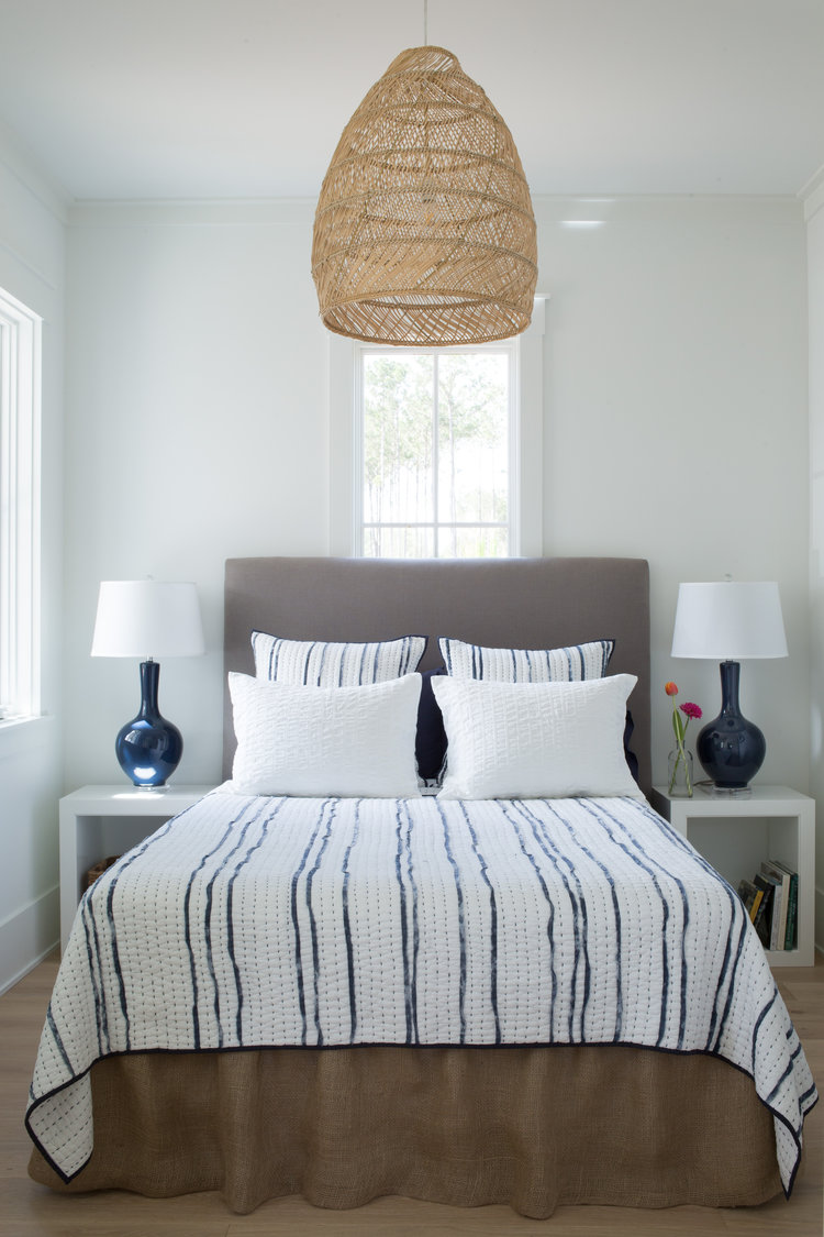 Benjamin Moore White paint color in coastal blue bedroom. Board and batten coastal cottage in Palmetto Bluff with modern farmhouse interior design by Lisa Furey.