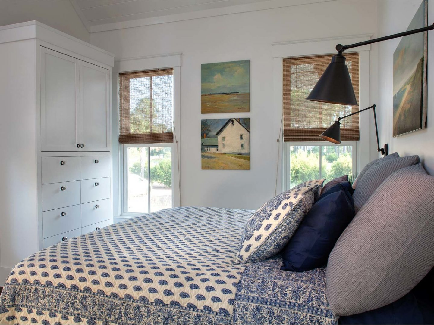 Blue and white coastal bedroom. Board and batten coastal cottage in Palmetto Bluff with modern farmhouse interior design by Lisa Furey.