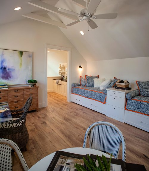 Blue bunk room in carriage house. Board and batten coastal cottage in Palmetto Bluff with modern farmhouse interior design by Lisa Furey.
