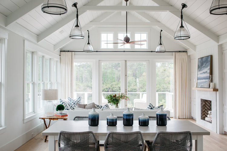 Dining room. Board and batten coastal cottage in Palmetto Bluff with modern farmhouse interior design by Lisa Furey.
