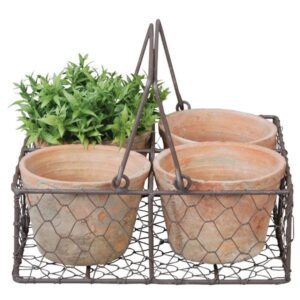 Aged terracotta pots in metal basket