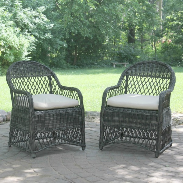Belgian stone patio with dark grey rattan chairs. Hello Lovely Studio. #rattan #patio #chairs