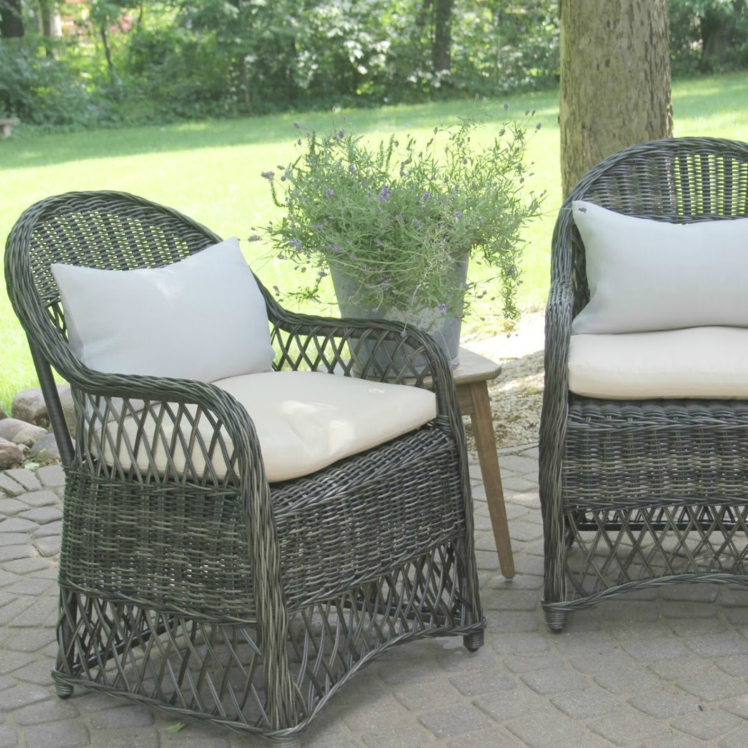 Grey rattan patio chairs with light blue linen lumbar pillows create a peaceful conversation area outdoors - Hello Lovely Studio. Come explore 3 looks for a modern outdoor oasis!