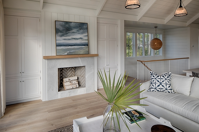 Fireplace in living room. Board and batten coastal cottage in Palmetto Bluff with modern farmhouse interior design by Lisa Furey.