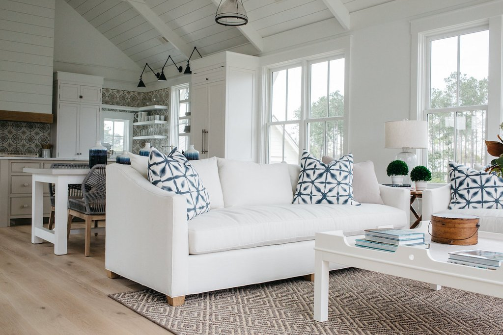 White living room. Board and batten coastal cottage in Palmetto Bluff with modern farmhouse interior design by Lisa Furey.