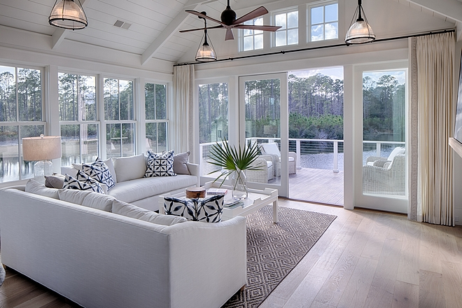 Living room. Board and batten coastal cottage in Palmetto Bluff with modern farmhouse interior design by Lisa Furey.