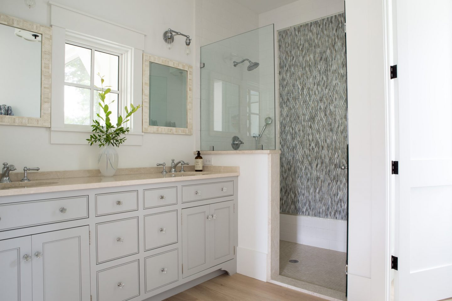 Master bath. Board and batten coastal cottage in Palmetto Bluff with modern farmhouse interior design by Lisa Furey.