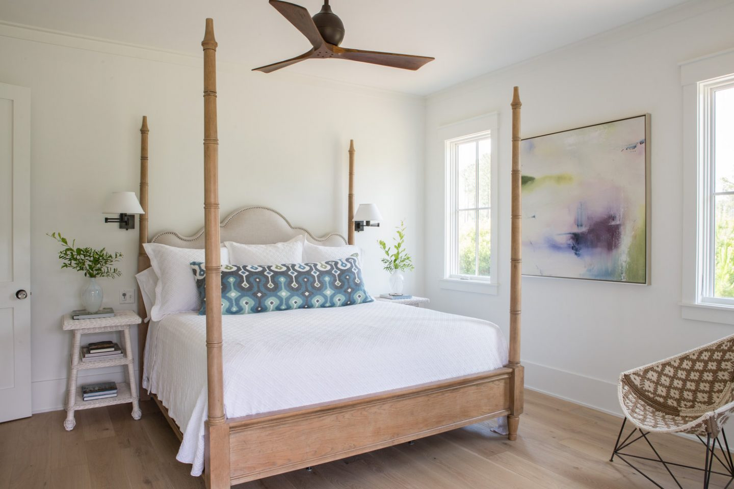 Master bedroom with poster bed. Board and batten coastal cottage in Palmetto Bluff with modern farmhouse interior design by Lisa Furey.