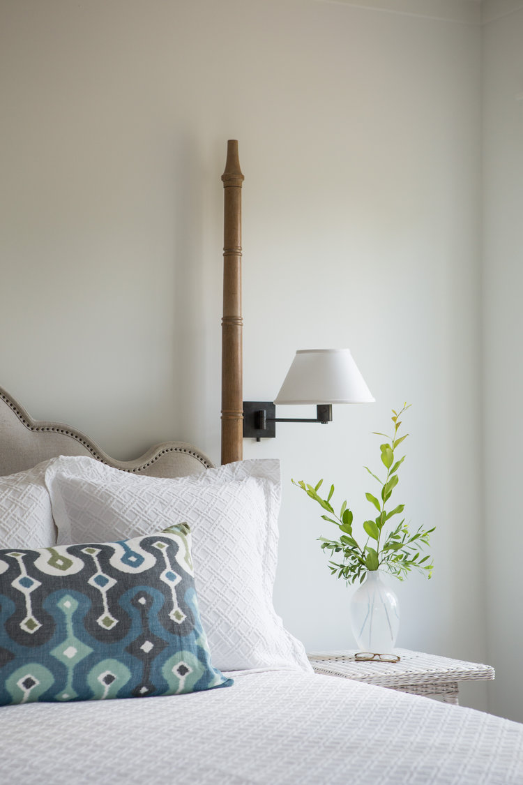 Benjamin Moore White paint color in master bedroom poster bed. Board and batten coastal cottage in Palmetto Bluff with modern farmhouse interior design by Lisa Furey.