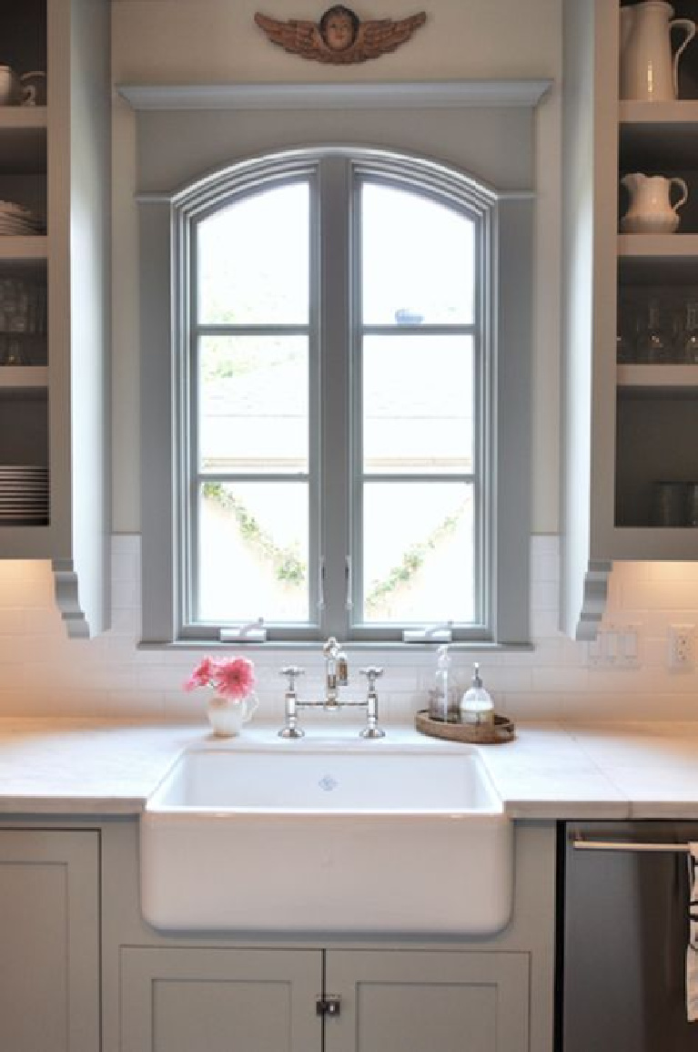 window detail + gray + subway tile + farmhouse sink | Sally Wheat Interiors. Come see 36 Best Beautiful Blue and White Kitchens to Love! #blueandwhite #bluekitchen #kitchendesign #kitchendecor #decorinspiration #beautifulkitchen