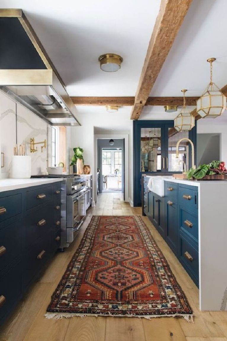 Blue kitchen with waterfall island and beamed ceiling. Come see 36 Best Beautiful Blue and White Kitchens to Love! #blueandwhite #bluekitchen #kitchendesign #kitchendecor #decorinspiration #beautifulkitchen