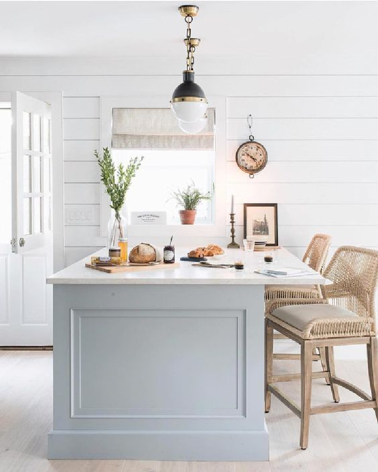 Bright Bazaar designed kitchen with grey painted island, midcentury modern pendants, and shiplap on walls. 23 Tranquil Interiors with Light Grey and White and be inspired! #greyandwhite #lightgrey #serenedecor