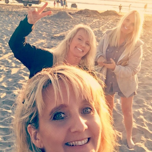 Three blonde sisters on La Jolla beach at sunset.