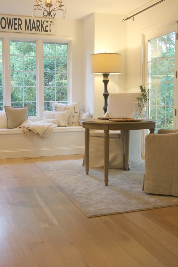 White oak hardwood flooring in a European inspired neutral home with spare interiors by Hello Lovely Studio. Learn more in this story about Wood Flooring Options: Engineered or Hardwood? #woodfloors #whiteoak #hellolovelystudio