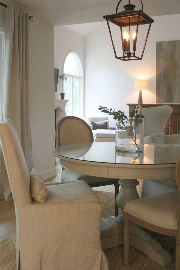 European country inspired serene dining room - Hello Lovely Studio. When You Need the Perfect Linen Slipcovered Chairs & Linen Upholstered Seating...certainly a lovely collection of options indeed.