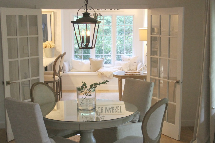 Dining room with round table and easy, simple, serene European country decor. Come see more of my home in Hello Lovely House Tour in July. #hellolovelystudio #timeless #tranquil #interiordesign #europeancountry #europeanfarmhouse #simpledecor #serenedecor