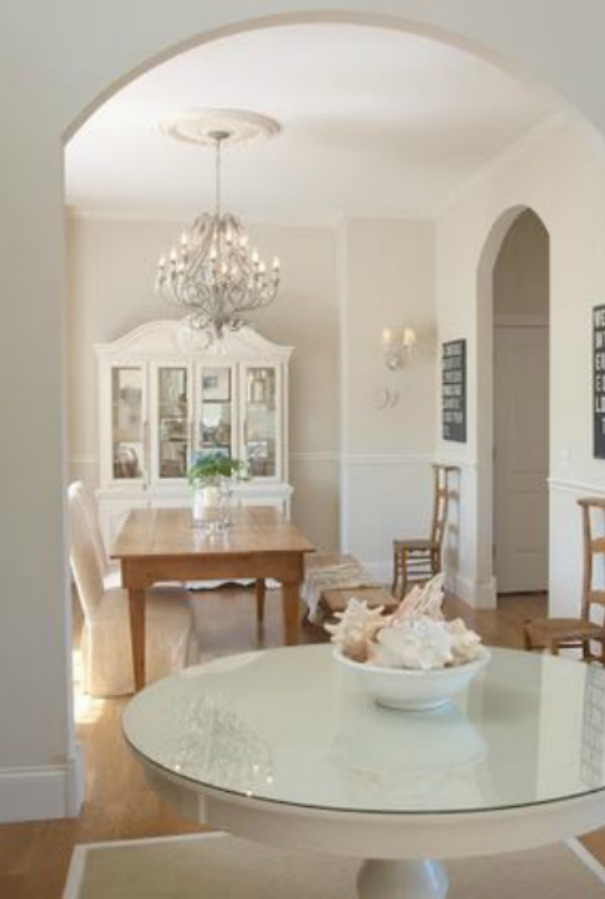 Foyer and dining room with wide arched doorway in our French country home. Hello Lovely Studio