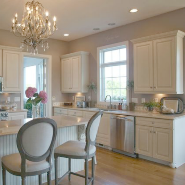 French country kitchen with grey walls and ivory cabinets. Hello Lovely Studio.