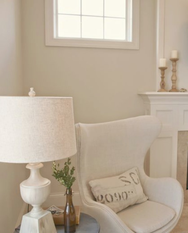 White Sand (Benjamin Moore) on walls of Hello Lovely Studio's living room with egg chair upholstered in Belgian linen. #paintcolors #benjaminmoorewhitesand #whitesand #interiordesign #toneontone #hellolovelystudio