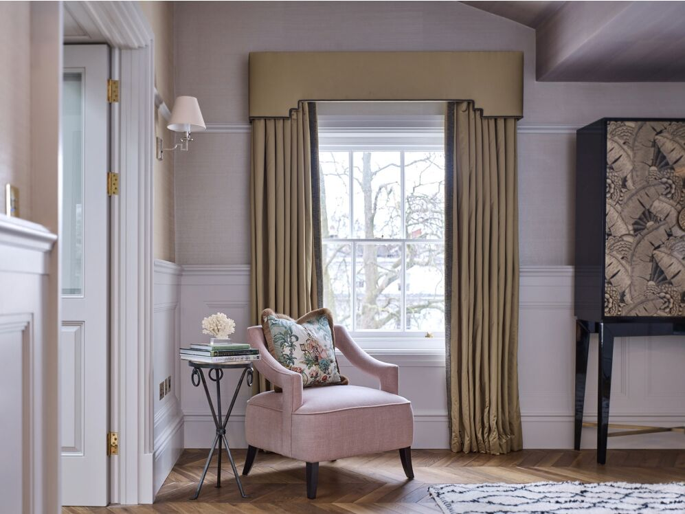 Blush pink chair in Sitting room in London apartment. Colorful Classic Decor in London Inspired by 'Out of Africa' - come see more from Studio L London! #britishcolornial #livingroom #pinkandgreen #elegantdecor #Londonapartment #interiordesigninspiration