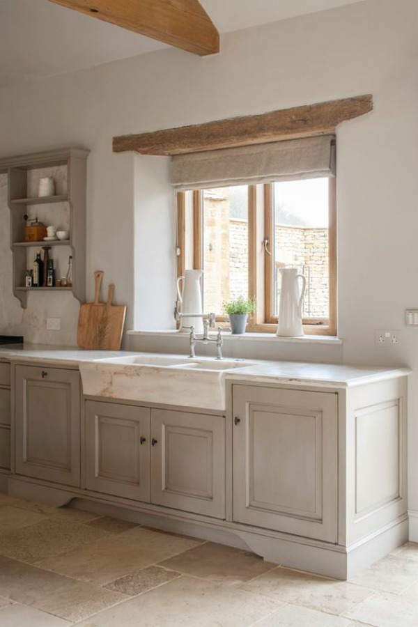 Bespoke kitchen designed by Artichoke with Flemish design influences and French farmhouse style. Marble farm sink, glazed cainbetry, and rustically natural wood beams. #frenchfarmhouse #kitchendesign #marblesink