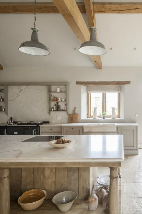 Bespoke kitchen by Artichoke with Flemish design and French farmhouse influences including stone flooring, rustic beams, and European country decor.