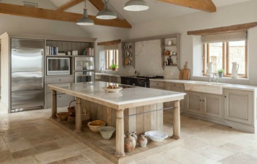Modern rustic bespoke kitchen by Artichoke in Gloucestershire, England. Flemish design details, painted kitchen cabinetry, bronze hardware, and Bental White marble