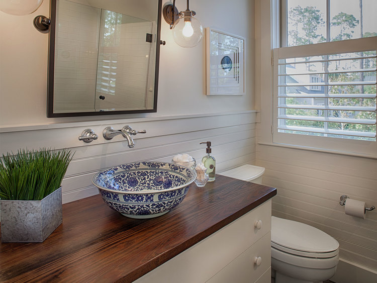 Coastal cottage bathroom with blue and white vessel sink. Design by Lisa Furey.
