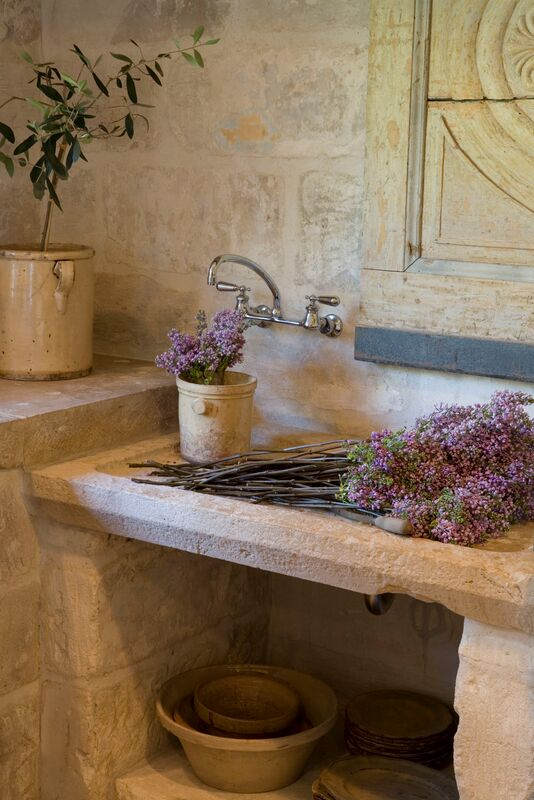 Chateau Domingue Timeless European Elegance and French farmhouse style converge in this house tour of founder Ruth Gay's home on Hello Lovely. Reclaimed stone, antique doors and mantels, and one of a kind architectural elements. #housetour #frenchcountry #frenchfarmhouse #europeanfarmhouse #chateaudomingue #rusticdecor #pamelapierce #elegantdecor #limestone #antique #stonesink