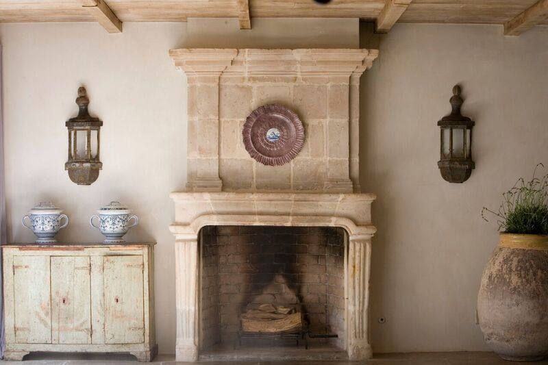 Chateau Domingue Timeless European Elegance and French farmhouse style converge in this house tour of founder Ruth Gay's home on Hello Lovely. Reclaimed stone, antique doors and mantels, and one of a kind architectural elements. #housetour #frenchcountry #frenchfarmhouse #europeanfarmhouse #chateaudomingue #rusticdecor #pamelapierce #elegantdecor #fireplace #ruthgay