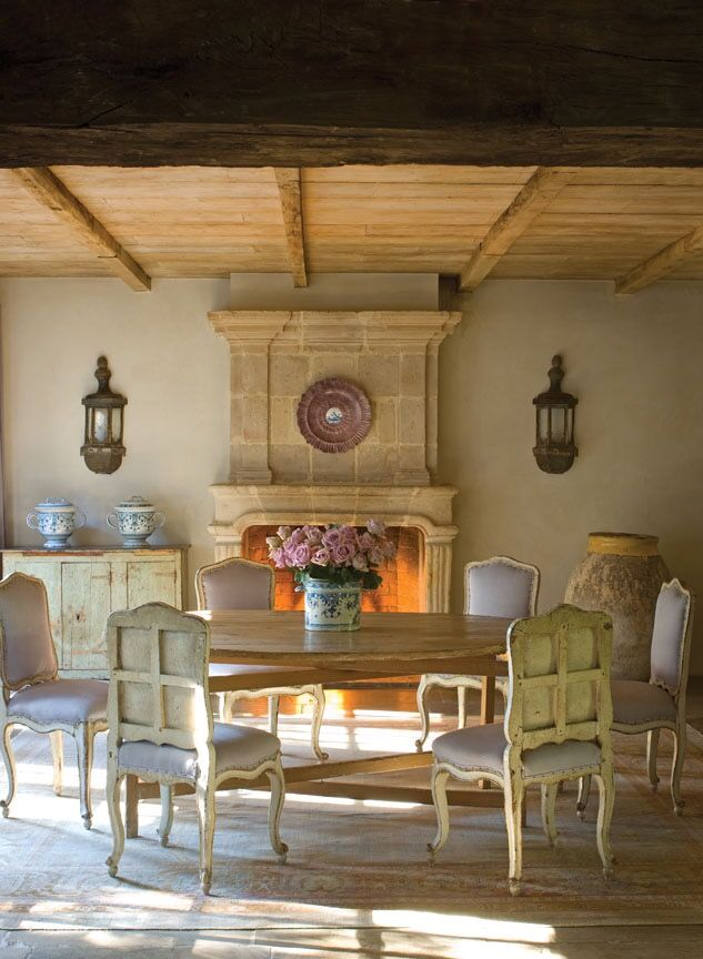 Beautiful French stone fireplace from Chateau Domingue in Ruth Gay's lovely home. See more fireplace design inspiration in this post. #frenchcountry #fireplace #chateaudomingue #interiordesign