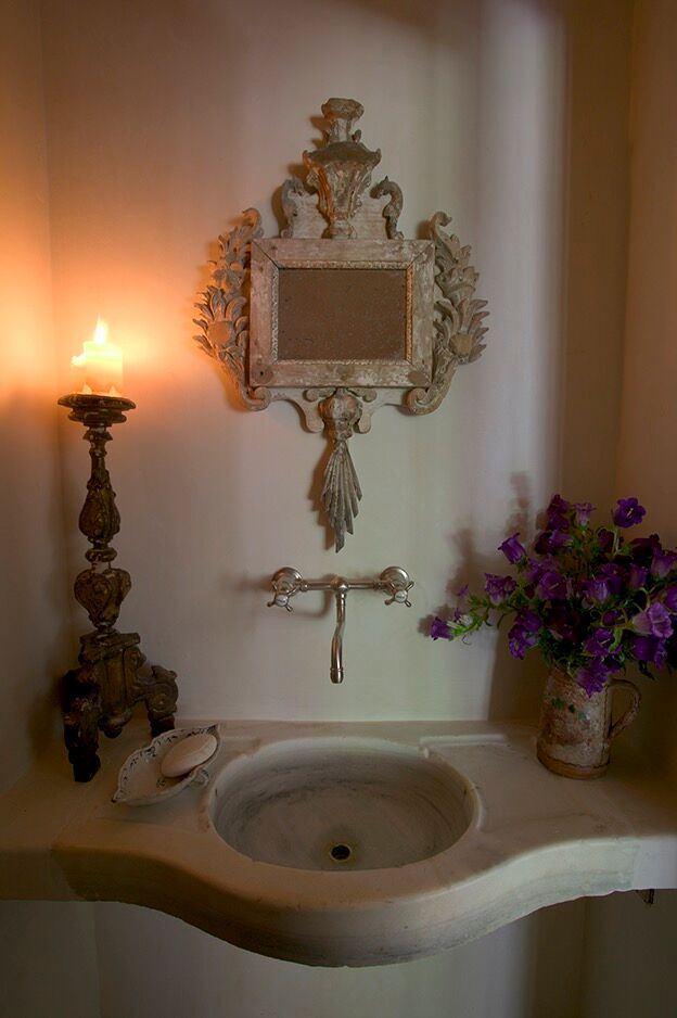 Chateau Domingue Timeless European Elegance and French farmhouse style converge in this house tour of founder Ruth Gay's home on Hello Lovely. Reclaimed stone, antique doors and mantels, and one of a kind architectural elements. #housetour #frenchcountry #frenchfarmhouse #europeanfarmhouse #chateaudomingue #rusticdecor #pamelapierce #elegantdecor #bathroom #stonesink #ruthgay