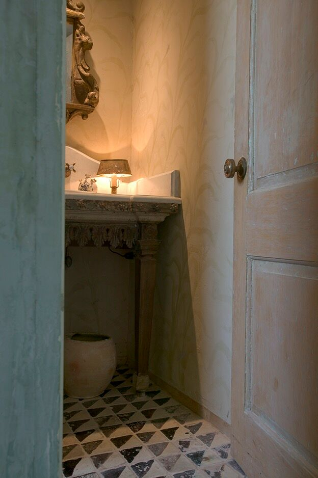 Chateau Domingue Timeless European Elegance and French farmhouse style converge in this house tour of founder Ruth Gay's home on Hello Lovely. Reclaimed stone, antique doors and mantels, and one of a kind architectural elements. #housetour #frenchcountry #frenchfarmhouse #europeanfarmhouse #chateaudomingue #rusticdecor #pamelapierce #elegantdecor #bathroom #oldworld
