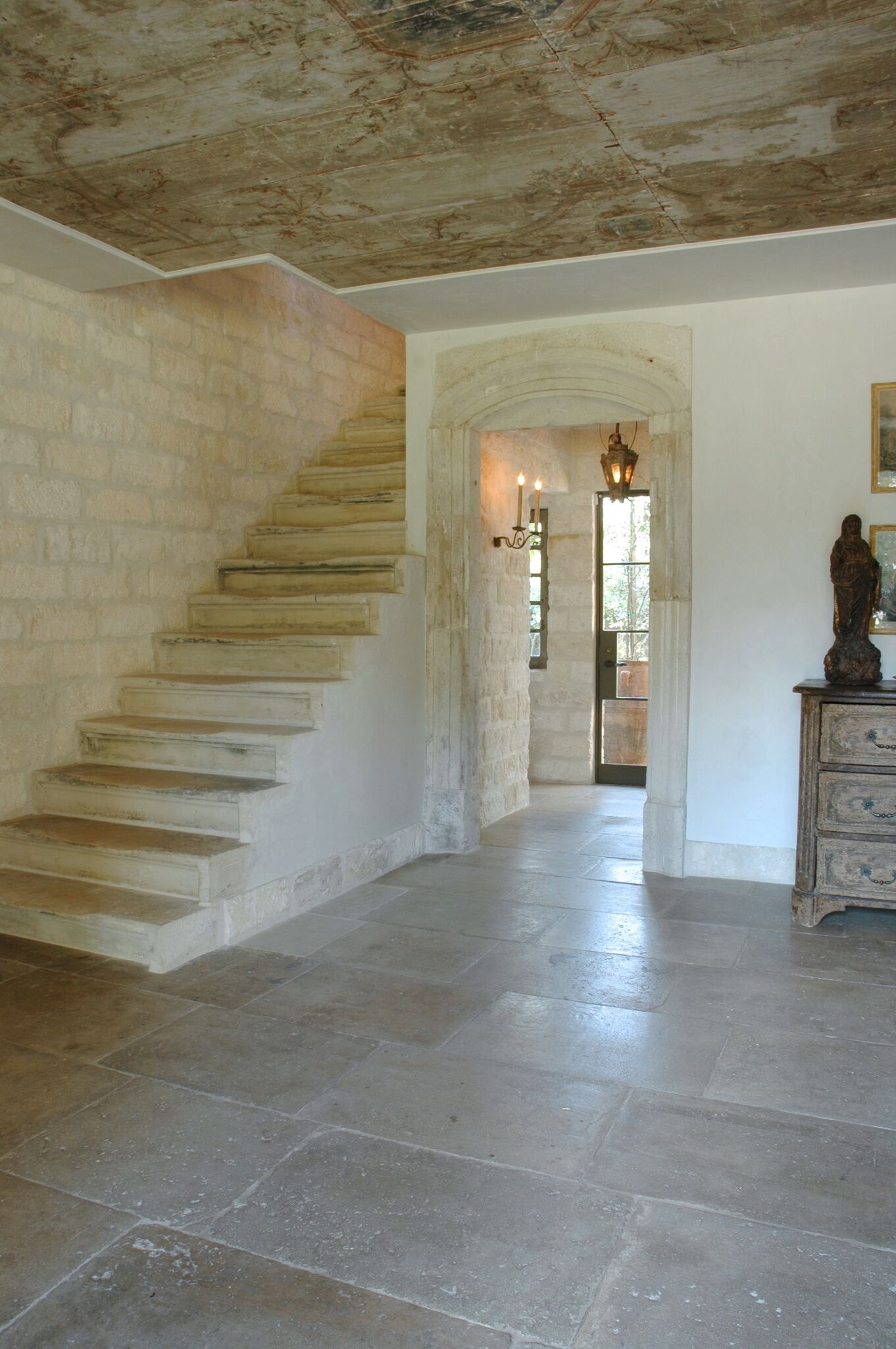 Chateau Domingue Timeless European Elegance and French farmhouse style converge in this house tour of founder Ruth Gay's home on Hello Lovely. Reclaimed stone, antique doors and mantels, and one of a kind architectural elements. #housetour #frenchcountry #frenchfarmhouse #europeanfarmhouse #chateaudomingue #rusticdecor #pamelapierce #elegantdecor #limestone #stairs #reclaimedstone