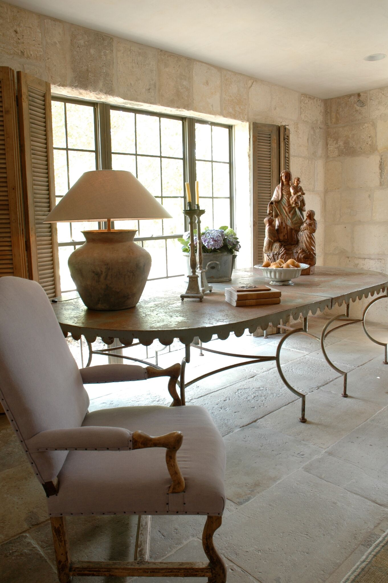 Chateau Domingue Timeless European Elegance and French farmhouse style converge in this house tour of founder Ruth Gay's home on Hello Lovely. Reclaimed stone, antique doors and mantels, and one of a kind architectural elements. #housetour #frenchcountry #frenchfarmhouse #europeanfarmhouse #chateaudomingue #rusticdecor #pamelapierce #elegantdecor #antiques #livingroom #limestone