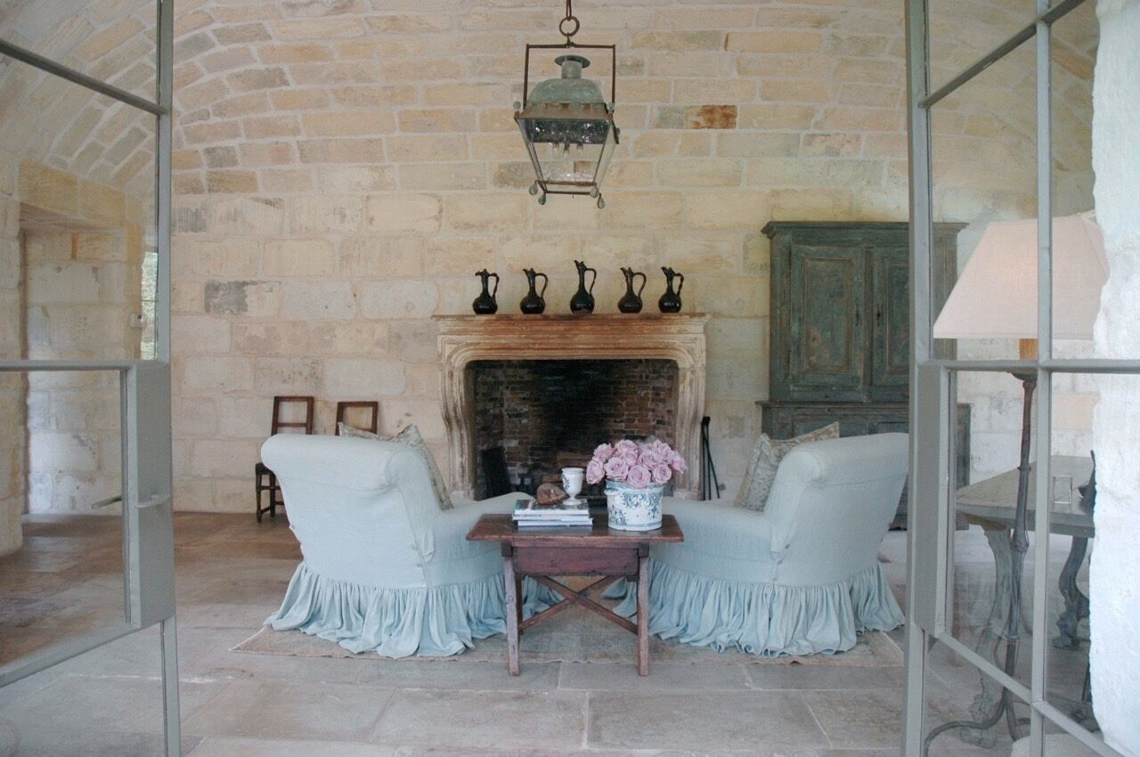 Chateau Domingue Timeless European Elegance and French farmhouse style converge in this house tour of founder Ruth Gay's home on Hello Lovely. Reclaimed stone, antique doors and mantels, and one of a kind architectural elements. #housetour #frenchcountry #frenchfarmhouse #europeanfarmhouse #chateaudomingue #rusticdecor #pamelapierce #elegantdecor #steeldoors #limestone #antiques
