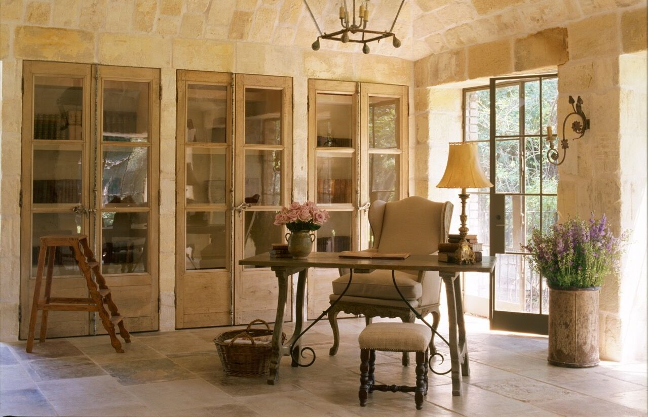 Chateau Domingue Timeless European Elegance and French farmhouse style converge in this house tour of founder Ruth Gay's home on Hello Lovely. Reclaimed stone, antique doors and mantels, and one of a kind architectural elements. #housetour #frenchcountry #frenchfarmhouse #europeanfarmhouse #chateaudomingue #rusticdecor #pamelapierce #elegantdecor #antiquedoors #limesstone #interiordesign