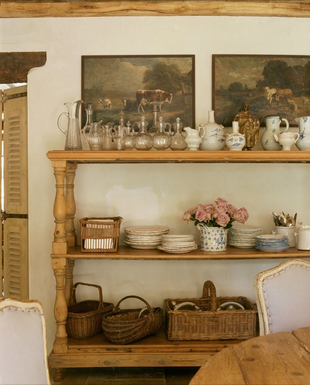 Chateau Domingue Timeless European Elegance and French farmhouse style converge in this house tour of founder Ruth Gay's home on Hello Lovely. Reclaimed stone, antique doors and mantels, and one of a kind architectural elements. #housetour #frenchcountry #frenchfarmhouse #europeanfarmhouse #chateaudomingue #rusticdecor #pamelapierce #elegantdecor #shelves